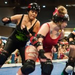 One of the jammers for the Cherry Bomb's tries to push one of the Rhinestone Cowgirls out of the way,Photo by Skylar Isdale