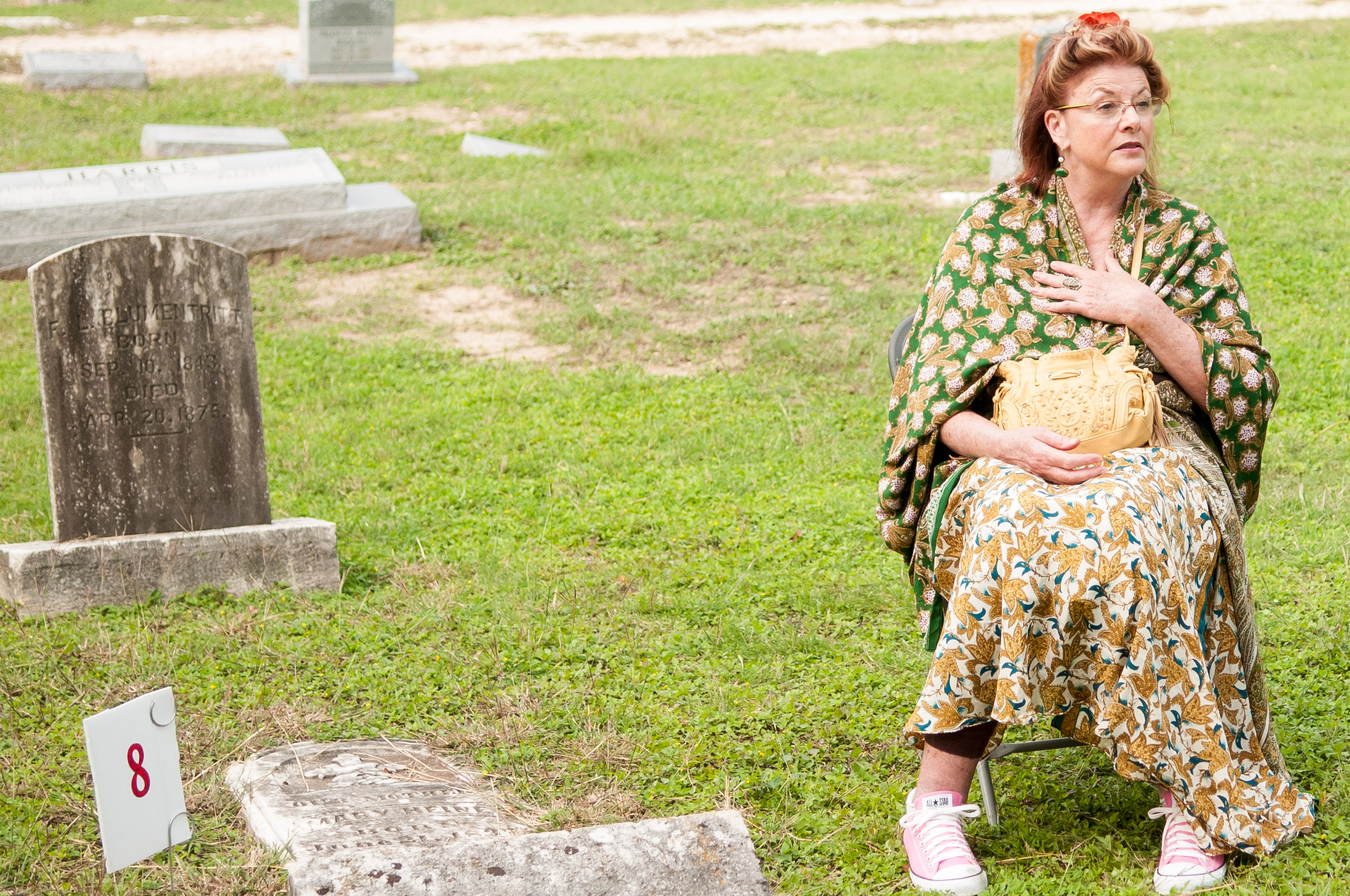 At the eighth and final stop on the tour, a storyteller shares her rehearsed story acting as the person buried at that grave. Photo by Skylar Isdale