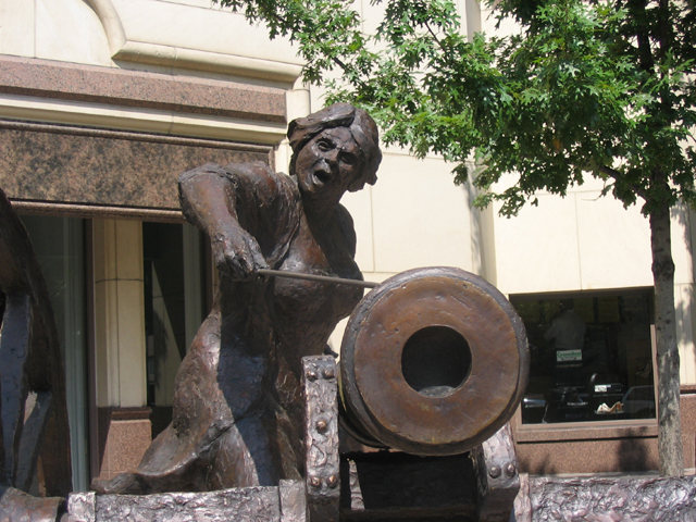 This statue of Angelina Eberly, an innkeeper and hero of the 1842 Texas Archive War, stands in the middle of downtown Austin, on Congress Avenue near 6th street. The sculpture was created by Pat Oliphant. Photo by Carlos Lowry.