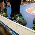 The skaters on the Cherry Bombs line up on the track to be introduced to the crowd.Photo by Skylar Isdale