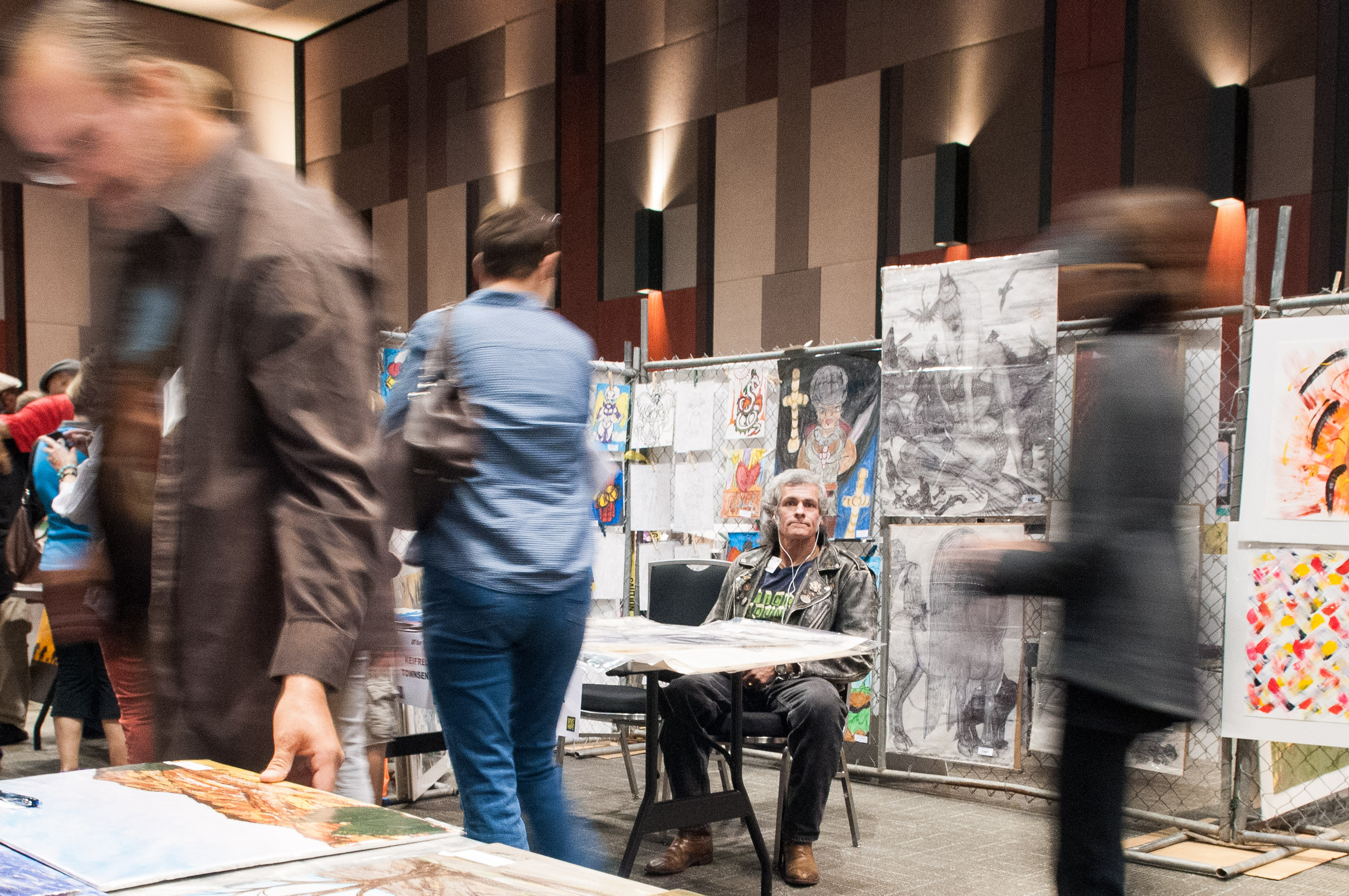 People walk throughout the Austin Convention Center looking at the various art pieces for sale. Photo by Skylar Isdale