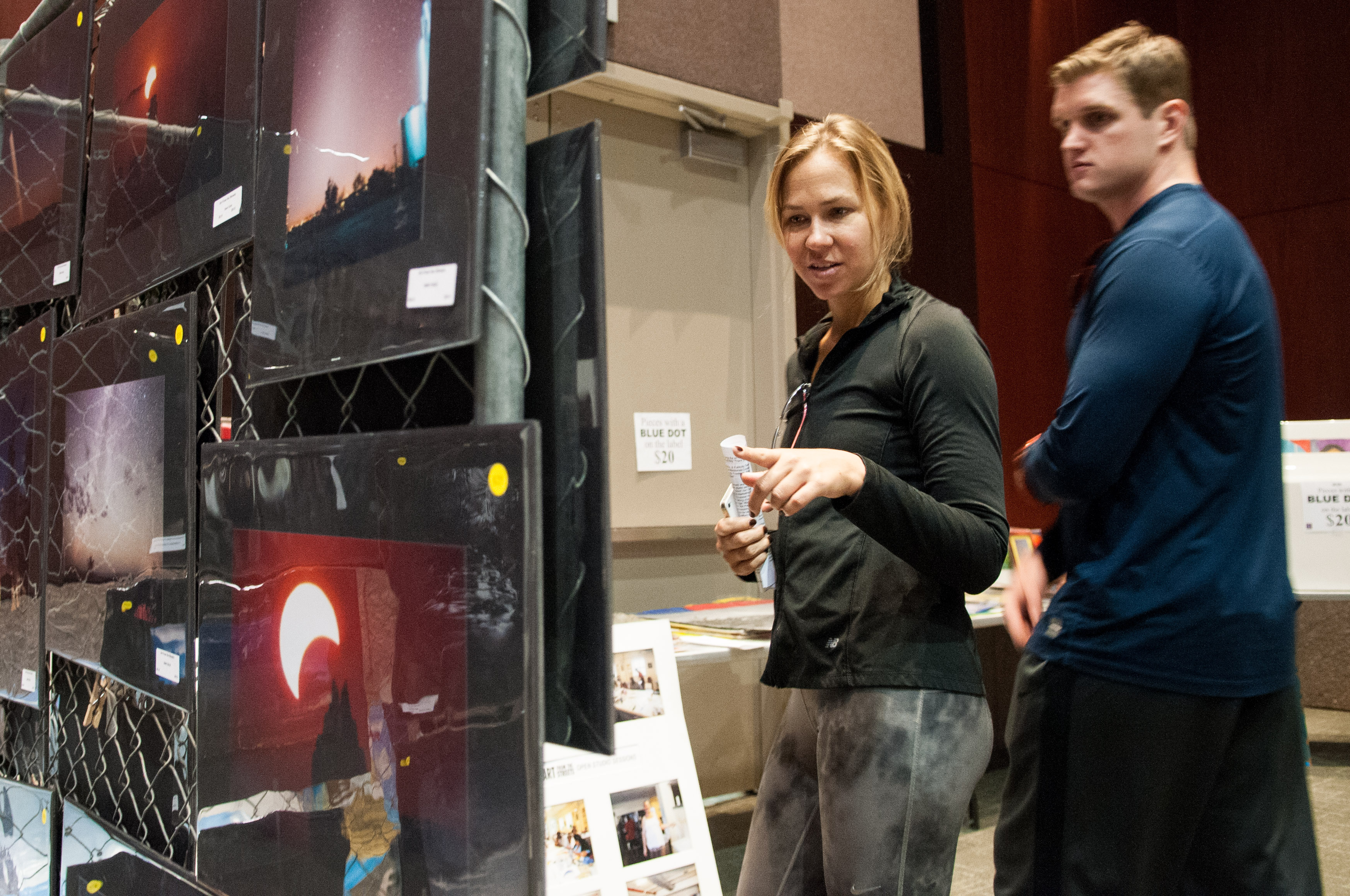 People are looking at the various art pieces for sale at the Austin Convention Center. Photo by Skylar Isdale