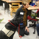 Sherry Stephens and Pepper help a Gullett Elementary School student read.