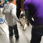 Maddie shakes hands with a Gullett Elementary School student.