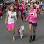 Two participants race to the finish line during the Pooch Scooch heat. Photo by Rebecca Wright