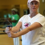 A Boob Camp participant works her upper body in a Saturday morning class. Photo by Rebecca Wright