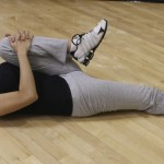 Hip Flexors:   Lying on the floor, hug the knee into the chest  avoiding pressure on the joints. Keep toes pointed toward the ceiling. The stretch is targeting the straight leg.