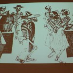 A cartoon illustration of the dancing dead plays along the walls of the Mexic-Arte Museum in Austin. Rhajibeiji Photography.