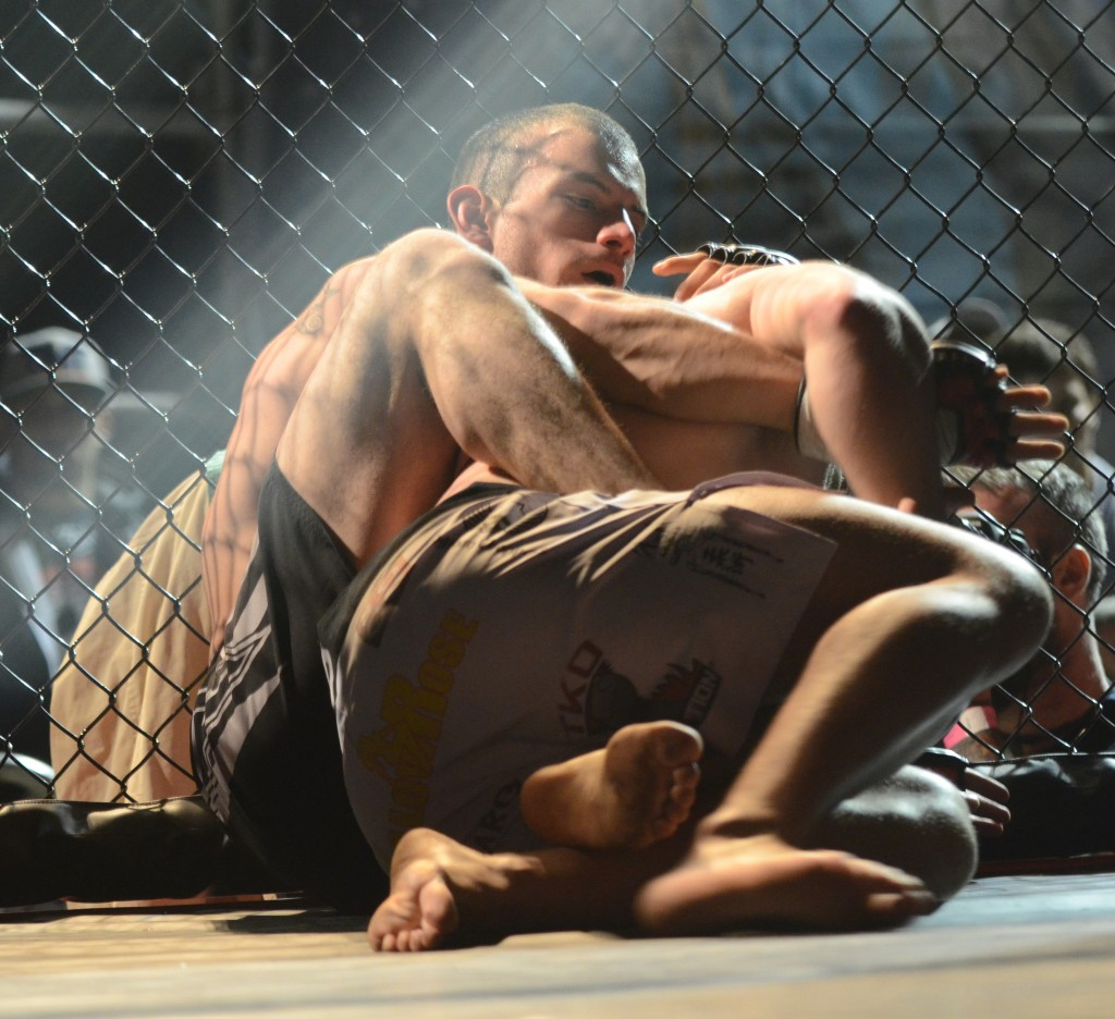 """Cristobal """"The Beast"""" Hernandez wrestles with Sean Clements in the Belts of Honorius 4 at the Nutty Brown Cafe & Amphitheatre Friday, Feb. 21. Photo By Angela Buenrostro"""