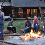 Workshop students relaxing by the camp fire. Photo by Jessica Duong