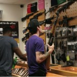 Customers and students shop for weapons and ammo in the CenTex store. The offer pistols, shotguns, handguns, glocks along with proper holsters for the gun and T-shirts for advertising.