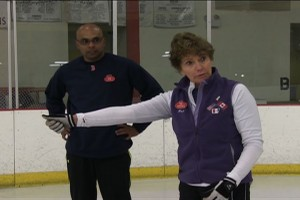Curling instructor Pat Popovich coaches a beginner curler