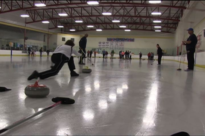 Instructor Pat Popovich curling at Chaparral Ice.