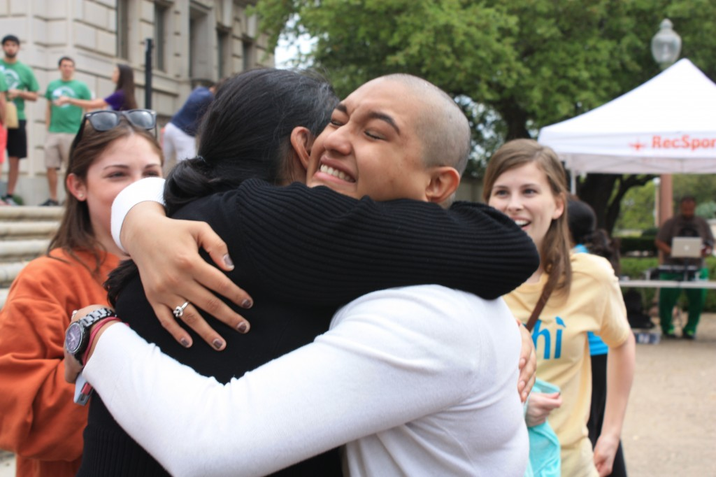 Carolina Media hugs her sister after braving the shave. Photo by Rachel Hill