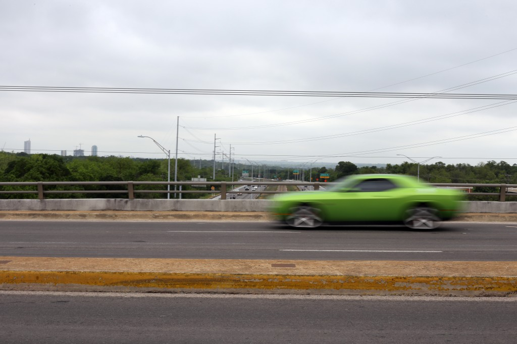 Traffic zooms over Mopac on the 35th street overpass. By Emma Banks