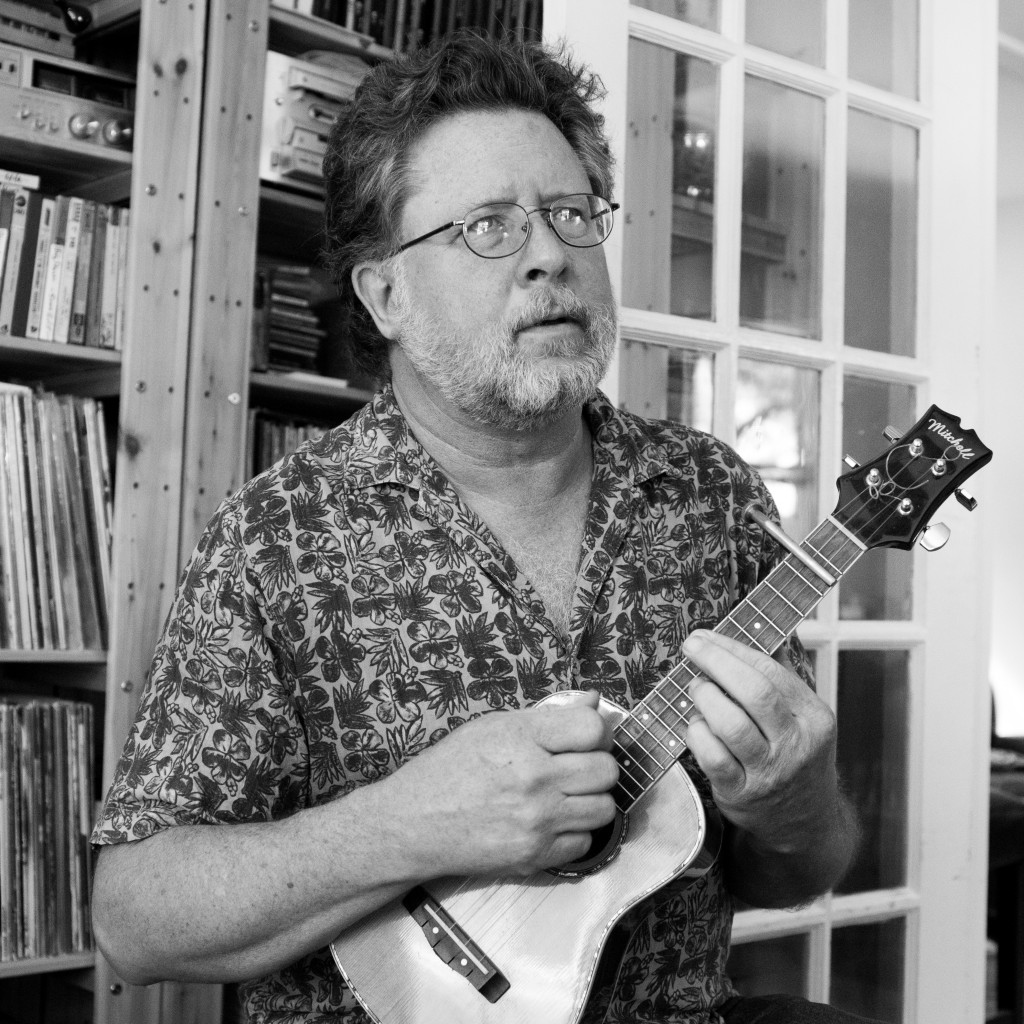 Conrad Deisler is one of the founders of the Austin Lounge Lizards and plays the guitar and mandolin.
