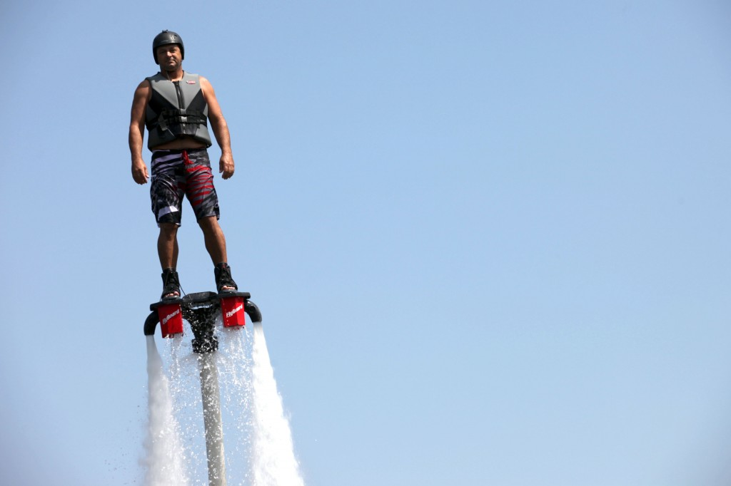 Hughes soars above Lake Austin on the Flyboard. The Flyboard can send riders over 30 feet above water. Hughes uses a 60 feet firehose, which allows him to elevate higher in the air. Photo by ChinLin Pan.