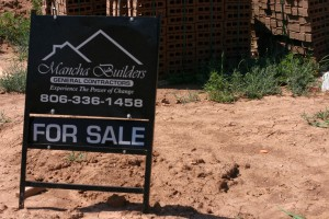 A for sale sign outside a Mancha Builders home in Amarillo, Texas.   (Photo Diego Contreras)