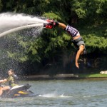 Fly Lake Austin owner Ed Hughes dives under water using his Flyboard, which uses water jets to propel riders to perform a number of trick, such as diving or back flips. Photo by Barbi Barbee.
