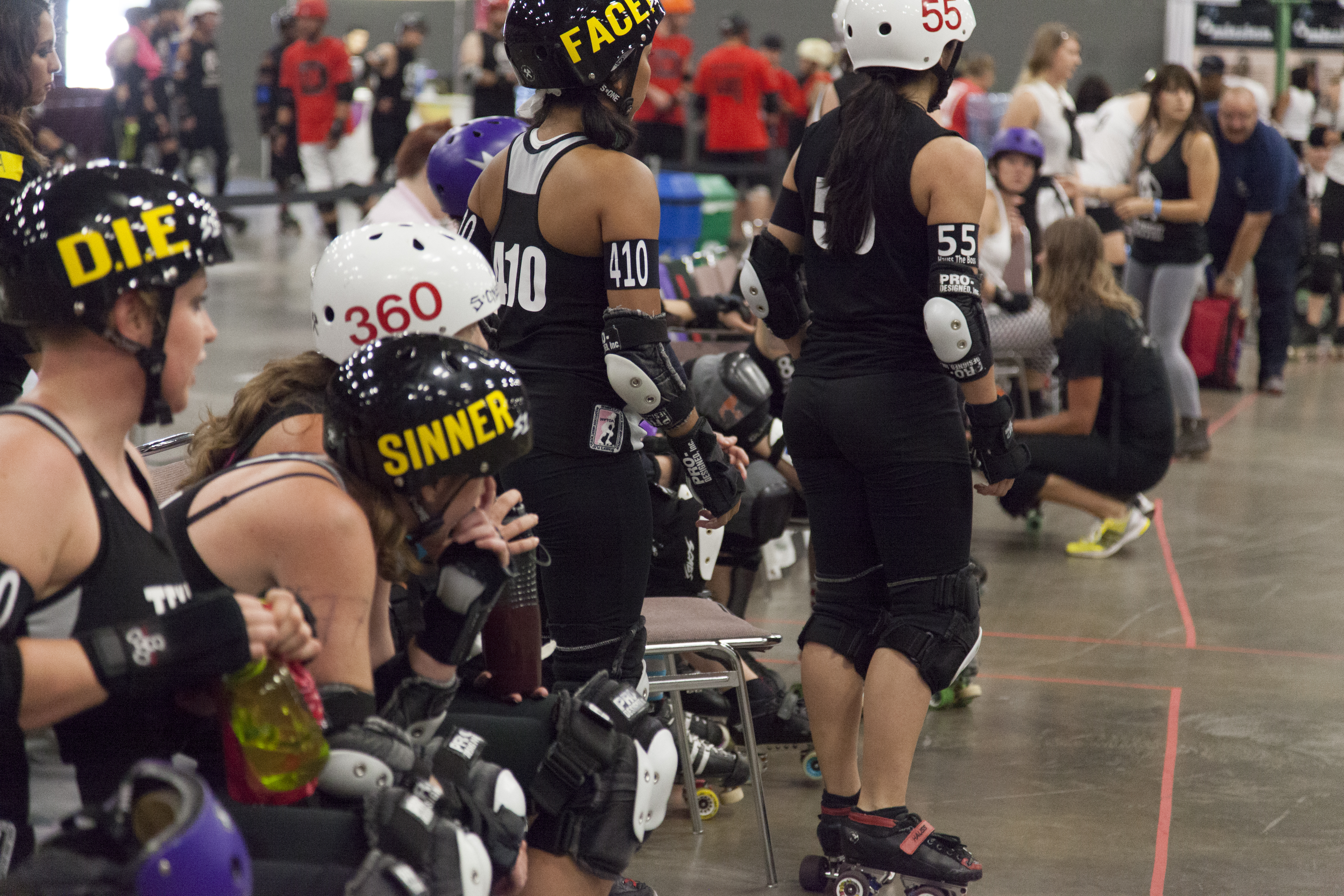 The Bar Belles watch anxiously during the bout.