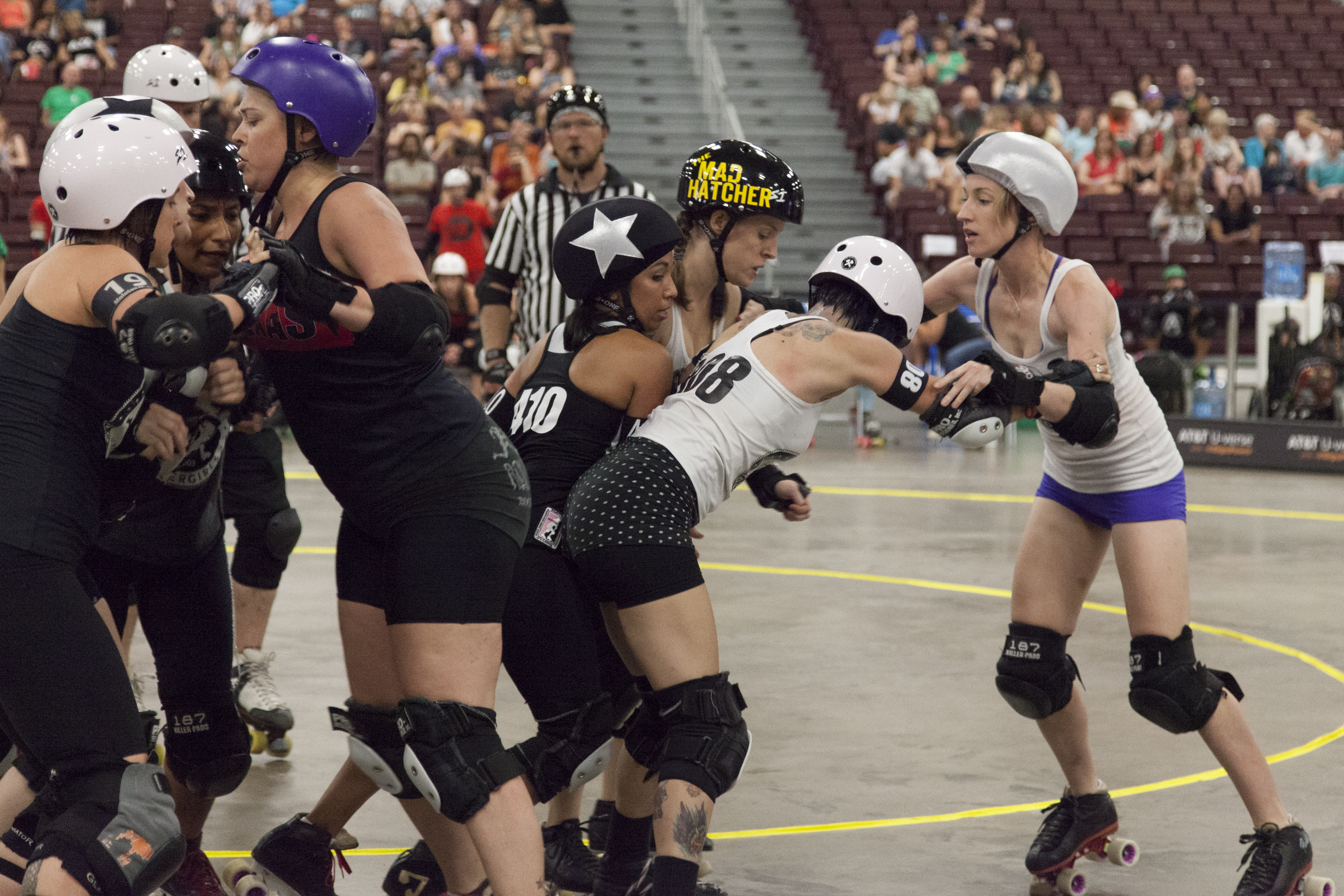 The Bar Belles and Clean N Jerks fight it out during the bout at the Naturally Fit Games.