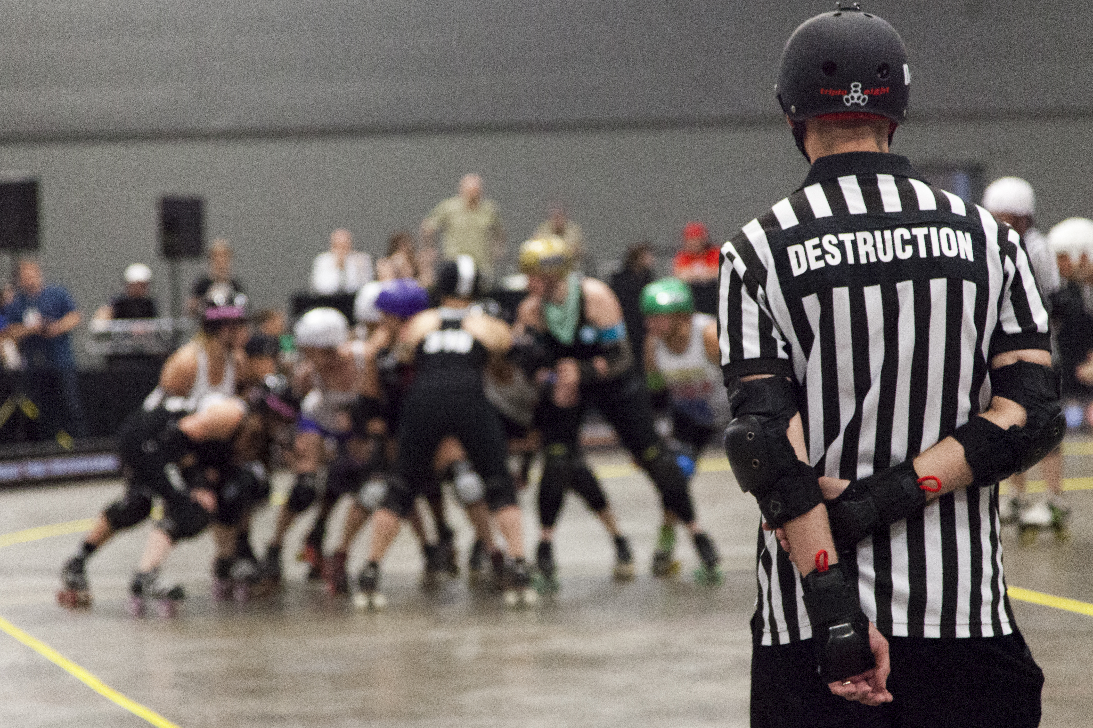 "Referees are allowed alter ego names as well. Here ""Destruction"" looks onto the game."