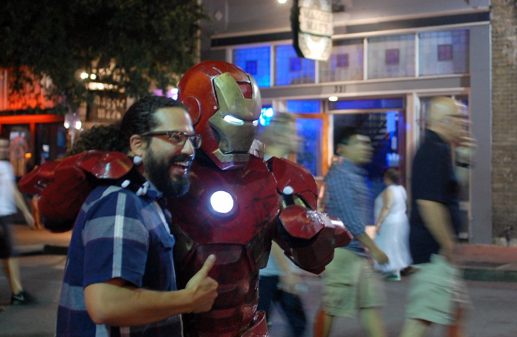Lee, suited in his Iron Man costume, takes a photo with a fan in the middle of Sixth Street. Photo by ChinLin Pan.
