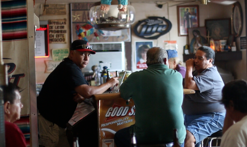 Eddie Costilla, owner of La Perla, (left) chats with a few of his regulars, Tomas (center) and Edward (right), on a Wednesday afternoon. Stopping for a drink at La Perla is a ritual for them on their way home from work. Photo by: Christina Noriega