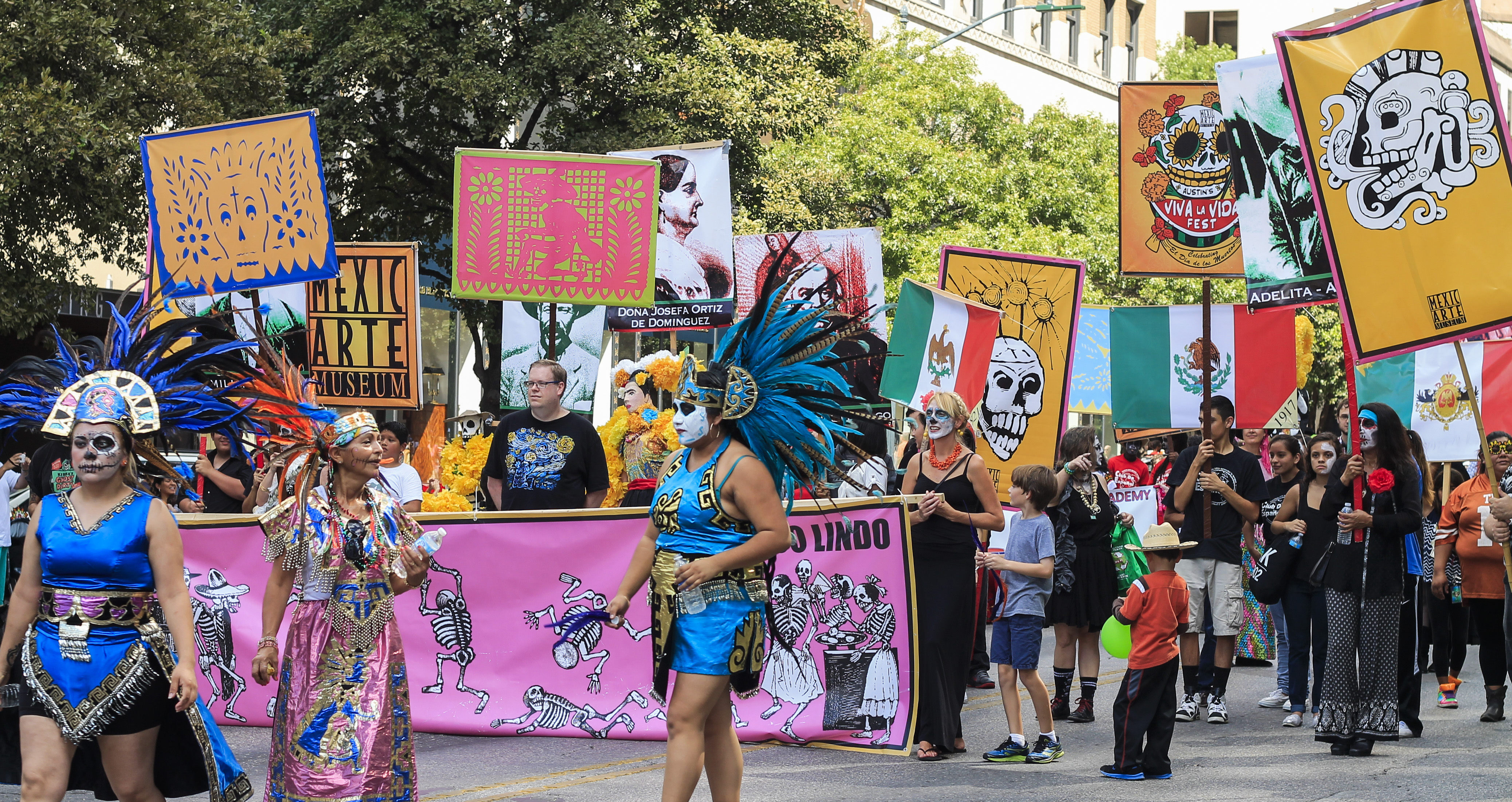Dancers and attendees march through downtown Austin during the Mexic-Arte Musem's Viva la Vida parade on October 18th. The festival was one of many Dia de los Muertos celebrations around the city. Photo by Alex Vickery. Editing by Olivia Starich.