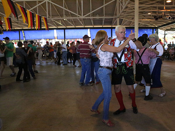 Dancers crowd the floor as live polka music fills the beer garden. Wurstfest member and Senior Opa Bill Holden, has been dancing for 46 years. Holden said he first began dancing in seventh grade, when his parents sent him to the Arthur Murray Dance Studio located in Austin, Texas. Photo by Larisa Manescu.