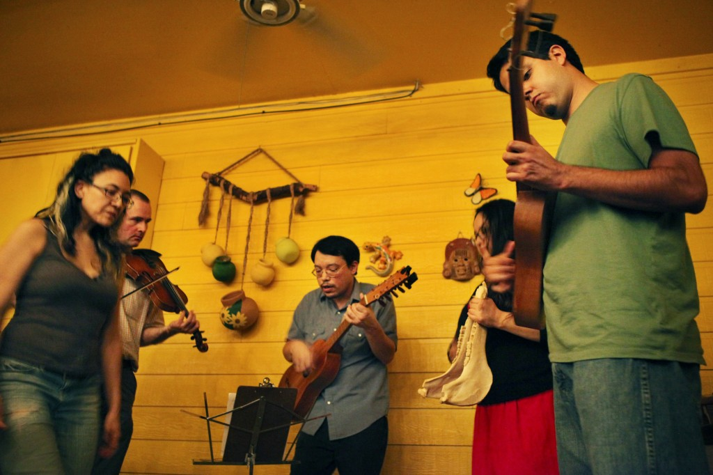 "Members of the music group Son Armado perform at Mi Madre's Restaurant in East Austin every Wednesday. The group performs a genre of music called ""son jarocho,"" which originates from Veracruz, Mexico. (Credit: Jamie Justine Balli)"