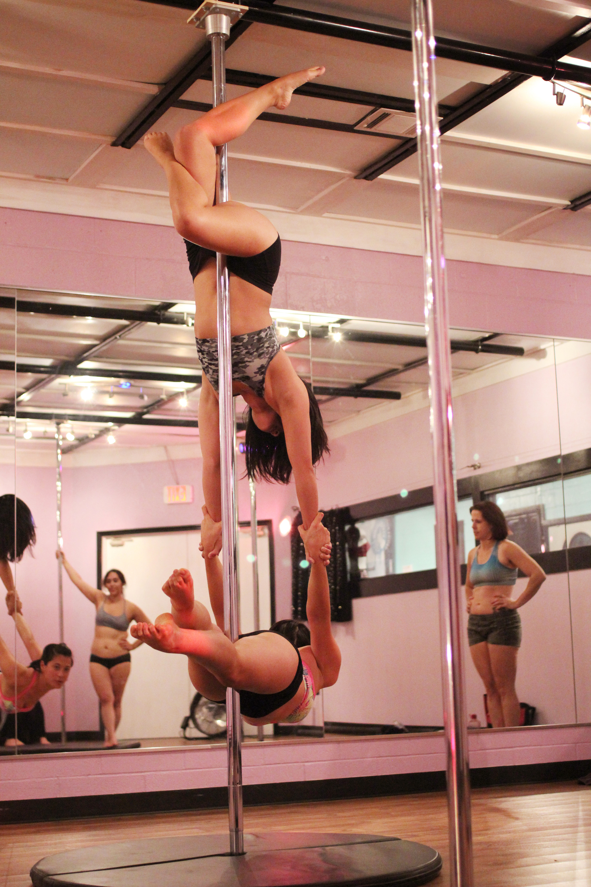 A Two Person Pole Move Is An Advanced Skill That Requires Dancers To Have Lots Of