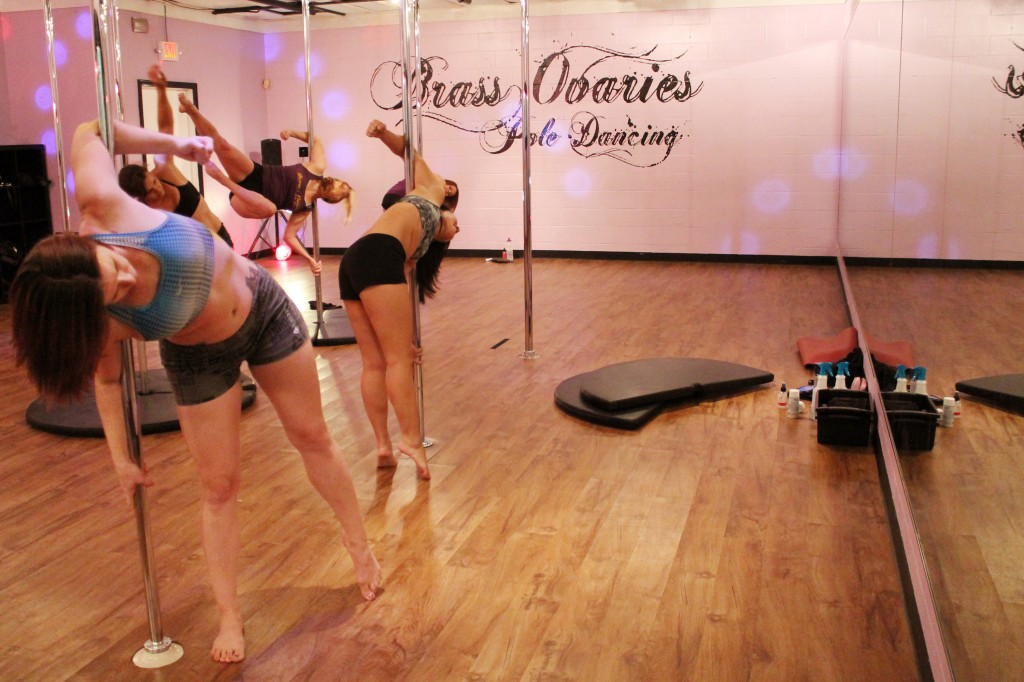 Brass Ovaries has two pole dancing studios where instructors teach daily classes. In the main studio, students can practice their moves and get one on one feedback from the instructor. (Credit: Larisa Manescu)