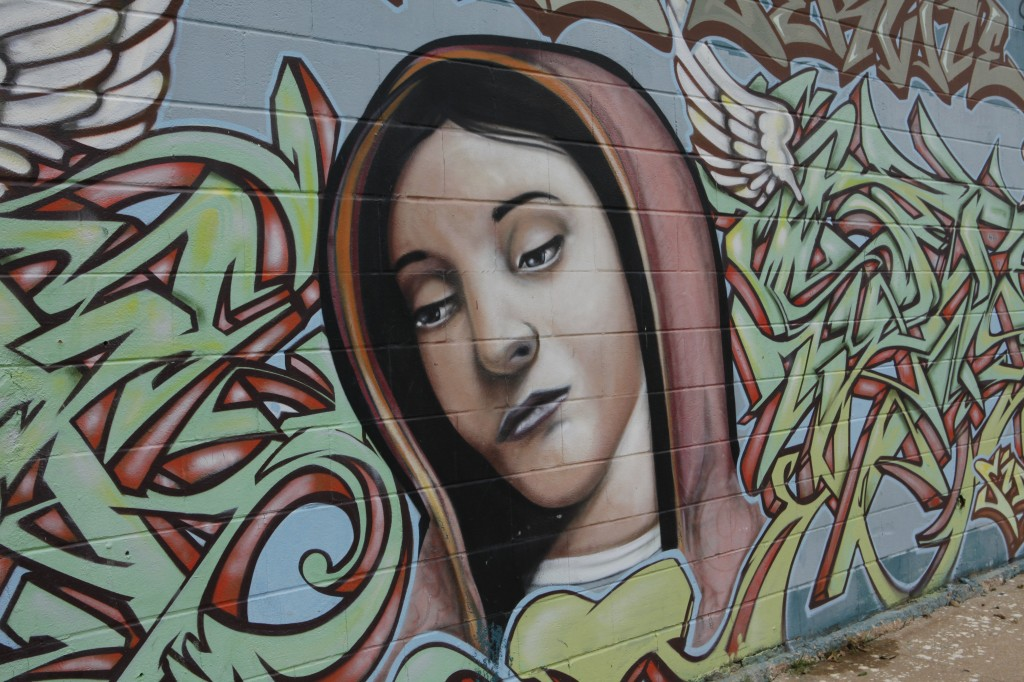 The Virgin Mary, a piece created by Sloke and Rei, is located on Cesar Chavez and Pedernales street. It was created with other art pieces around the wall that are dedicated in celebration of Dia de los Muertos. (Credit: Jamie Balli)