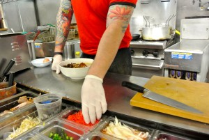 David Cardena makes a bowl of Shiner miso ramen. East Side King uses many offbeat ingredients for their fusion dishes.