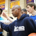"TJ Ford and his basketball camp players huddling up to chant ""hard work"" before rotating to the next station for more drills in the gym at Kinkaid High School in Houston Texas on Saturday, February 7, 2015. (Photo/Tessa Meriwether)"