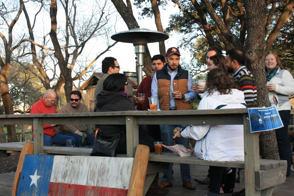 Customers socializing and drinking at Moontower Saloon in South Austin on Thursday, March 5, 2015. (Photo/Tessa Meriwether)