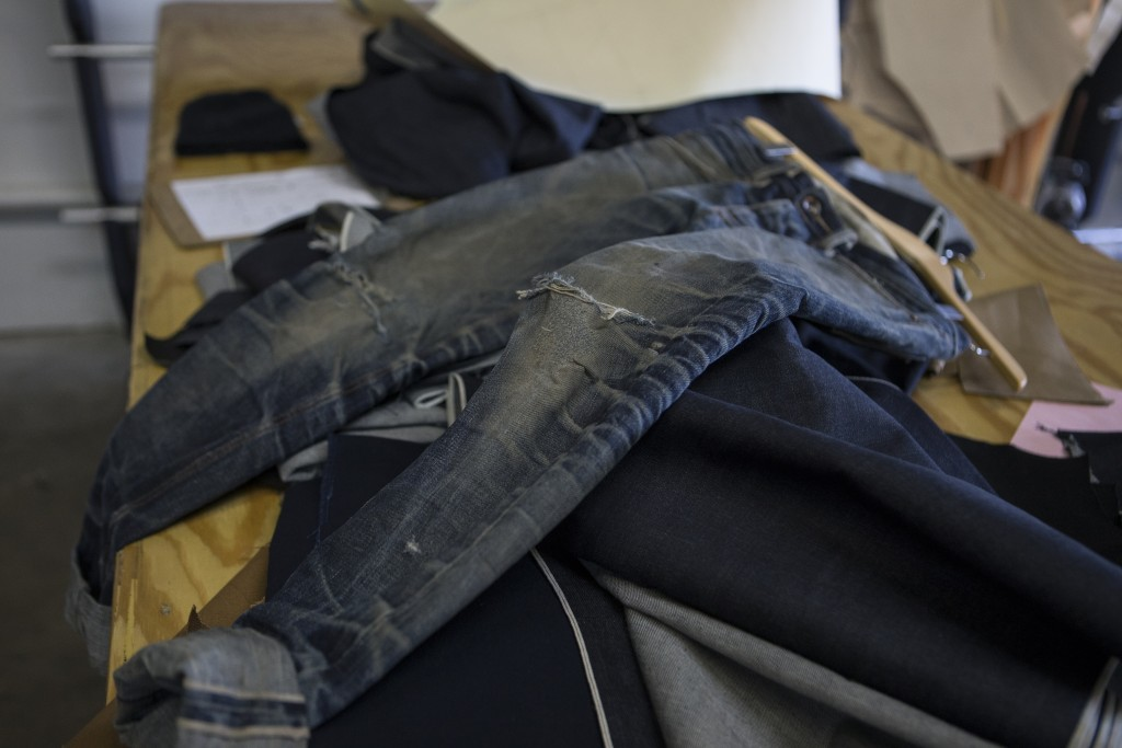 An example of what raw jeans look like when worn for over a year with minimal washing.