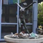 Figurine atop a bird bath in Bobby's Sculpture Stories Garden (Photo/ Tessa Meriwether)