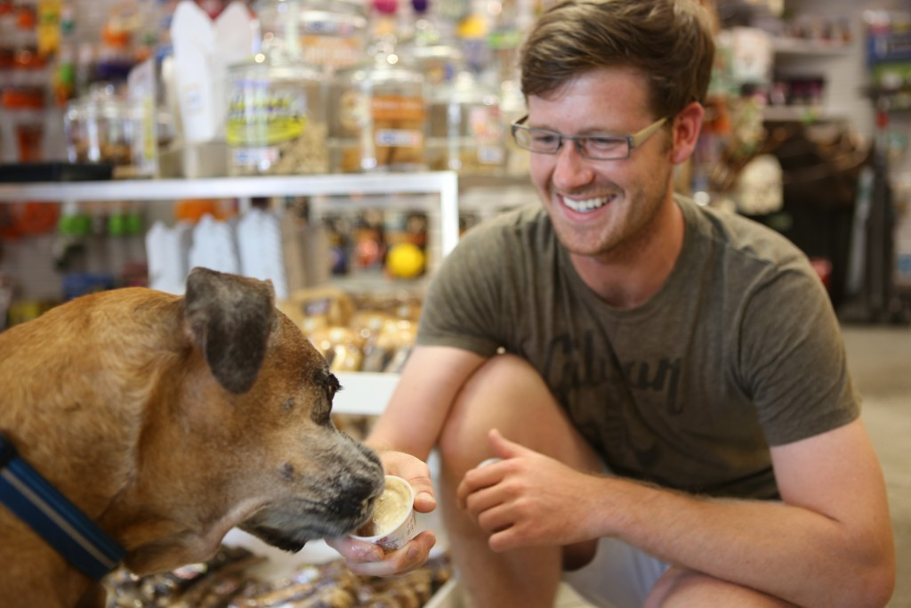 "Owner of Great Out Dogs Matt Edwards gives his dog Nugget some Shaggy Waggin ice cream, of which he's a huge fan. ""Once they get a taste, they will remember the container that delicious taste came from and will get just as excited as the first time they had it""."