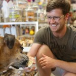 """Owner of Great Out Dogs Matt Edwards gives his dog Nugget some Shaggy Waggin ice cream, of which he's a huge fan. """"Once they get a taste, they will remember the container that delicious taste came from and will get just as excited as the first time they had it""""."""