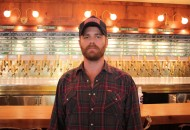 """Banger's owner-operator Ben Siegel stands proudly in front of said 104 beers on tap. Incidentally, a whopping 99 were recently switched to brand new beers for their """"4 Pigs-4 Ways"""" anniversary party and beer festival on August 1st, celebrating three years."""