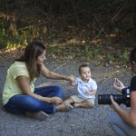 Photographer Sabrena Rexing attempts to get baby Trace's attention during a photoshoot.