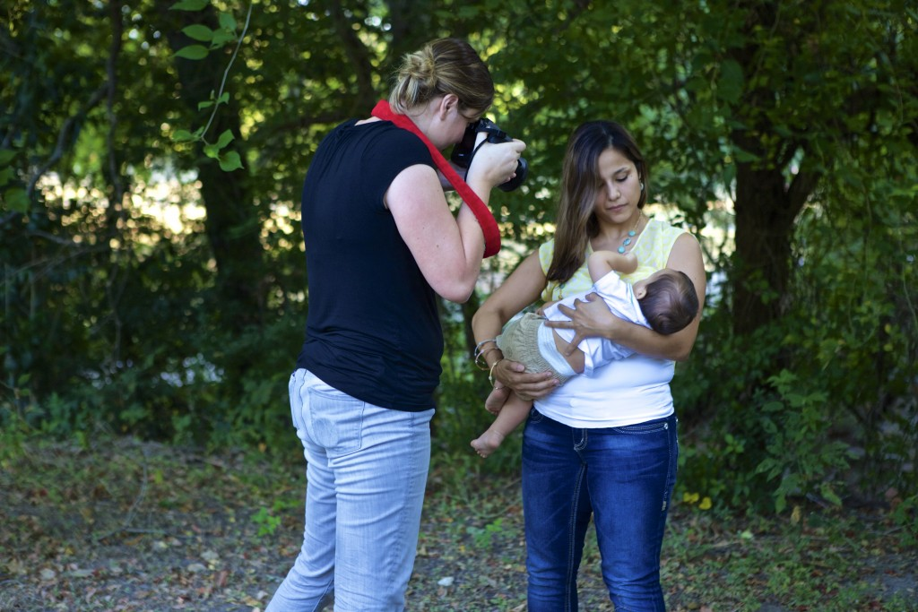 Photographer Sabrena Rexing takes pictures of Jenny Dorsey nursing her son Trace.