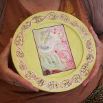 Bobbie Moore, shared four of her illustrations displayed on light weight dishes.