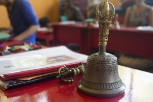 The Bell is topped by a half Vajra and clasped by lotus petals and leaves, it symbolizes wisdom, it is traditionally considered to be a female's principal. It is also the complementary object of the Vajra, which represents the male principal.