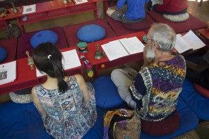 Jasper (right) and his wife, attend the monthly practice called Dakini Day practice which lasts two hours. During the practice they chant and perform the ritual.