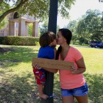 Lauren Yamada and her son Kai kiss in front of the Capitol.