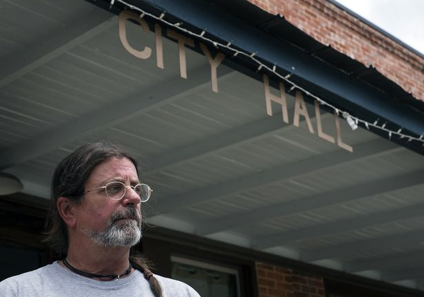 Mayor Randy Bunker stands out front of Martindale City Hall (Austin American-Statesman).