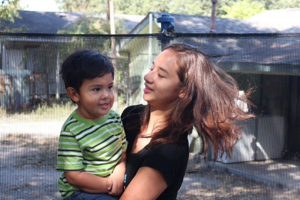 Dayana Sosa and her son Liam playing in their backyard on the North side of Houston.